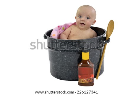 Six month baby girl sitting in a saucepan  - stock photo