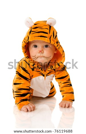 Six month baby wearing tiger suit sitting isolated on white - stock photo