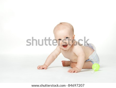 Six month boy sits on the white background and smiles - stock photo