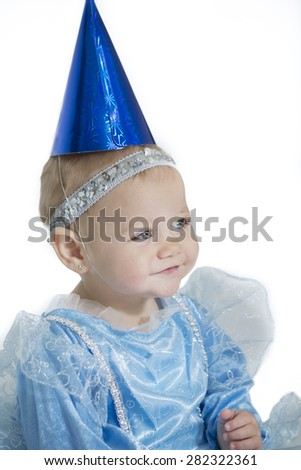 six month girl in blue princess costume  wearing a clown hat, isolated - stock photo