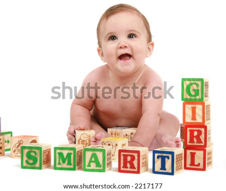 six month old baby girl with blocks - stock photo