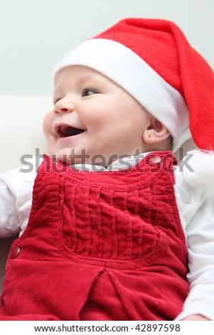 Six month old baby with santa cap