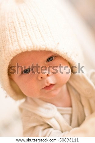 six months baby face with white hat indoor playing - stock photo