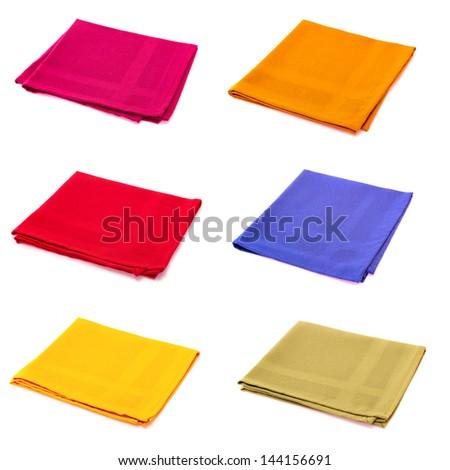 Six multicolored napkins isolated on white - stock photo