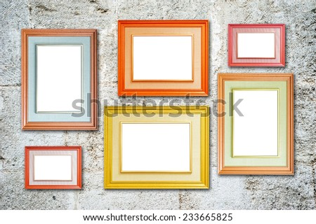 Six multicolored photo frames on the retro wall - stock photo