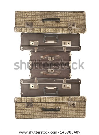 six old suitcase stacked with different size, isolated on white