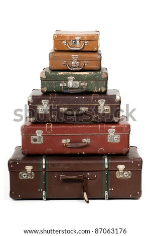 Six old suitcases - stock photo