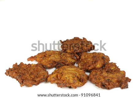 six onion bhajis on a white background - stock photo