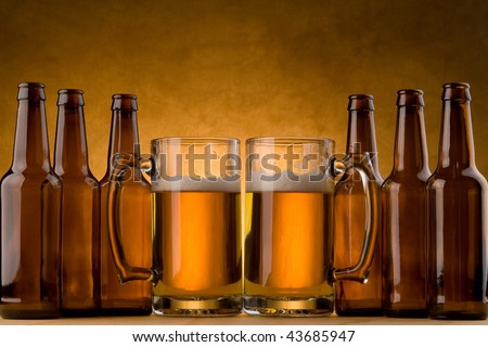Six pack of beer bottles and beer mugs - stock photo