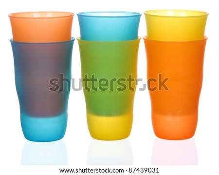 Six plastic multi-colored glasses isolated on a white background. Plastic glass of various color isolated on white background - stock photo