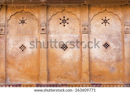Six-pointed star and the other symbols on the ancient wall of the estate in Rajasthan, India - stock photo