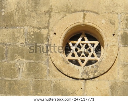 Six pointed star with Maltese cross - stock photo