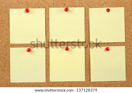 six post it notes on corkboard - stock photo