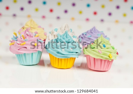 Six rainbow baby cupcakes with sprinkles