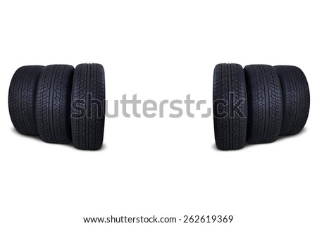 Six rubber tires with black color in the studio, isolated over white background - stock photo