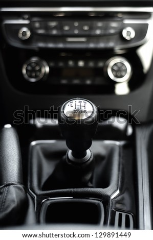 six speed gearstick of modern car against cockpit background - stock photo
