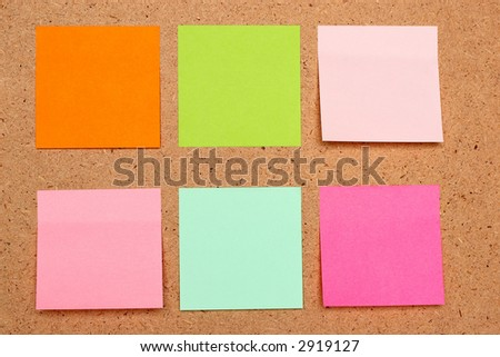 six sticky notes different colors on board