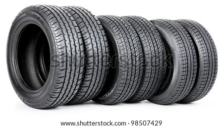 Six tires isolated on white - stock photo