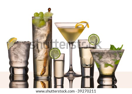 six vodka drinks on glass surface with reflection, white background