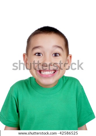 six-year-old boy making a silly face, with a big toothy smile, isolated on white background - stock photo