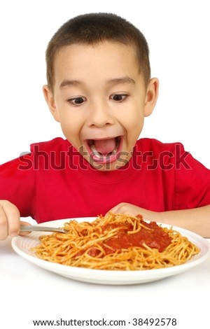 six year old boy with a full plate of spaghetti, isolated on white background - stock photo
