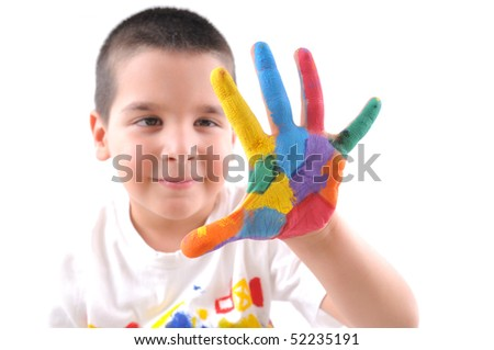 Six year old boy with hands painted in colorful paints makes a big five - stock photo