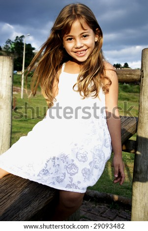 Six year old girl having a great time in an outdoor park. - stock photo