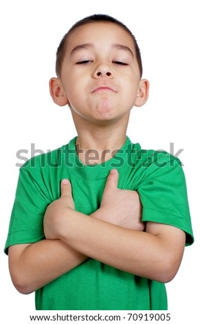 six year old kid with arms crossed, stubborn, isolated on pure white background