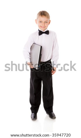 Six years Boy holding laptop isolated on white - stock photo