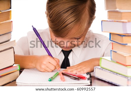 Six years boy writing in the notebook - stock photo