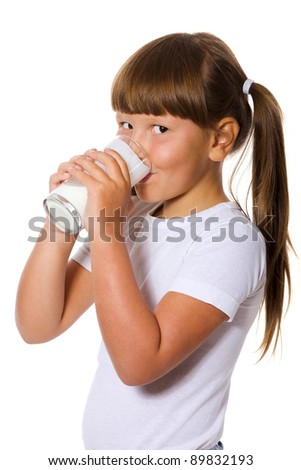 Six years Girl holding glass of milk isolated on white - stock photo