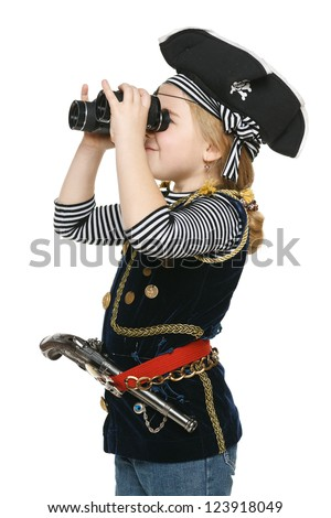 Six years girl wearing costume of pirate looking away through the binoculars, over white background - stock photo