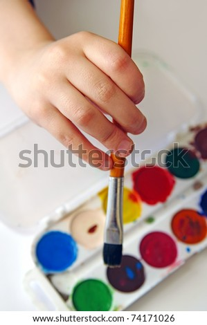 Six years old boy painting - stock photo