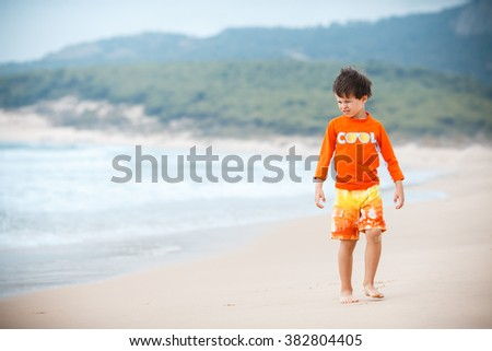 Six years old boy playing on exotic beach, Andalucia, Spain - stock photo