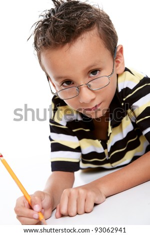 Six years old boy studying with glasses and a pencil in his hands, white background - stock photo