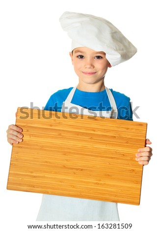 Six years old cook boy with kitchen board in the hand isolated on white - stock photo