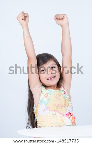 Six years old with accomplished gesture - stock photo