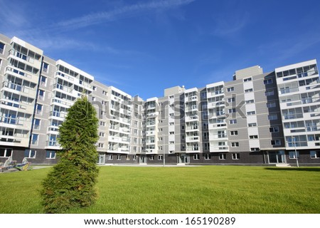 Sixstory apartment building in a residential complex. It is located on the picturesque glade near the village Romashkovo - stock photo