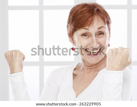 Sixty years woman face - stock photo