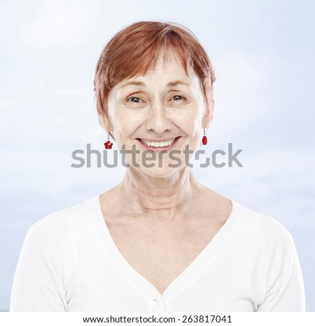 Sixty years woman smiling - stock photo