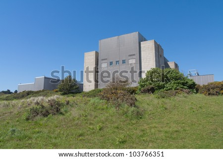 Sizewell A nuclear power station stands out against a blue sky.  It is in the process of being decommissioned. - stock photo