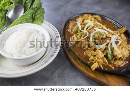 Sizzlin lemongrass chicken with jalapenos, turmeric and lettuce wraps - stock photo