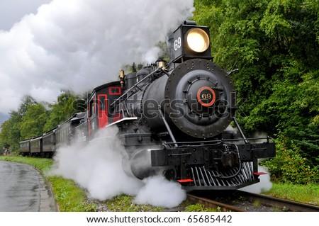 SKAGWAY, ALASKA - SEPT 7: Restored steam train of White Pass & Yukon RR runs as visitor attraction on Sept 7, 2008 in Skagway, Alaska - stock photo