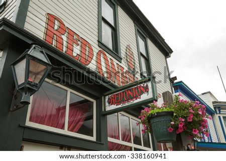SKAGWAY, ALASKA, USA - SEPTEMBER 20, 2011: The Red Onion Saloon is open to cruise ship tourists. This historic saloon opened in 1898 as a bar and brothel catering to gold rush miners. - stock photo