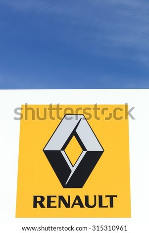 Skanderborg, Denmark - September 6, 2015: Renault logo on a wall. Renault is a french multinational automobile manufacturer established in 1899. The company produces a range of cars and vans. - stock photo
