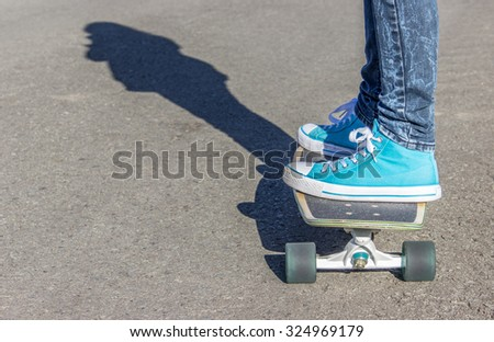 Skate board / Girl with blue shoes on a skateboard / Skate board / blue shoes