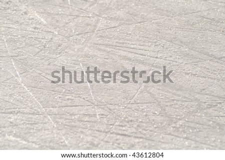 Skate marks on the ice surface of an ice rink - stock photo