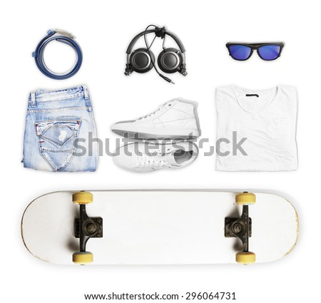 skateboard and wear and accessories on white background - stock photo