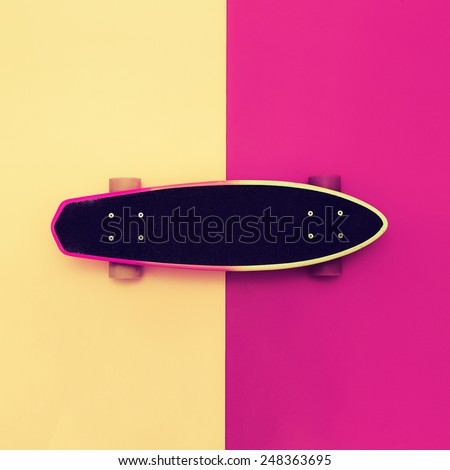 Skateboard on colorful background. Bright style Urban - stock photo