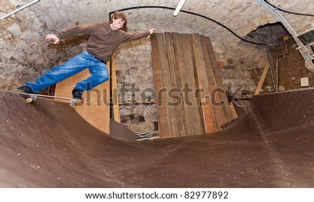 Skateboarder doing a drop in - stock photo